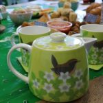 Tea pot, cups and cakes